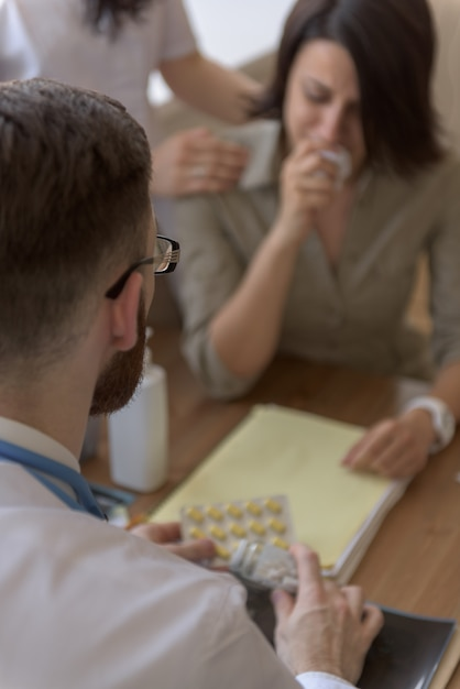 Doctor talking to crying patient after tests Premium Photo