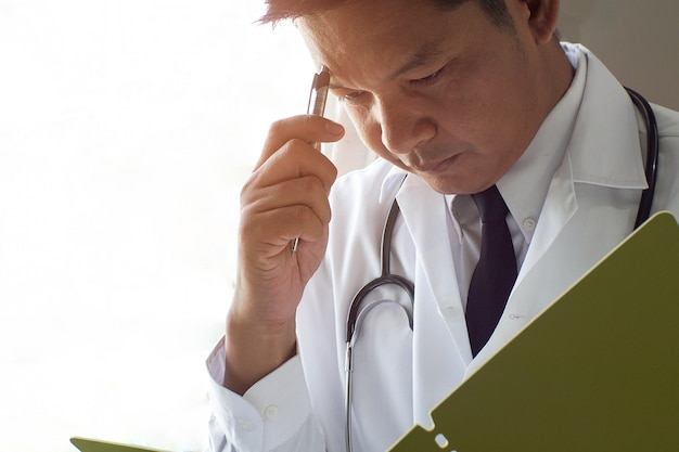 The doctor thinks and stresses when reading patient records. Premium Photo