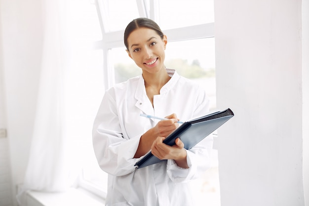 Doctor in a uniform standing on white Free Photo