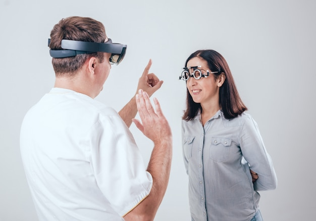 The doctor uses augmented reality glasses in ophthalmology. Premium Photo