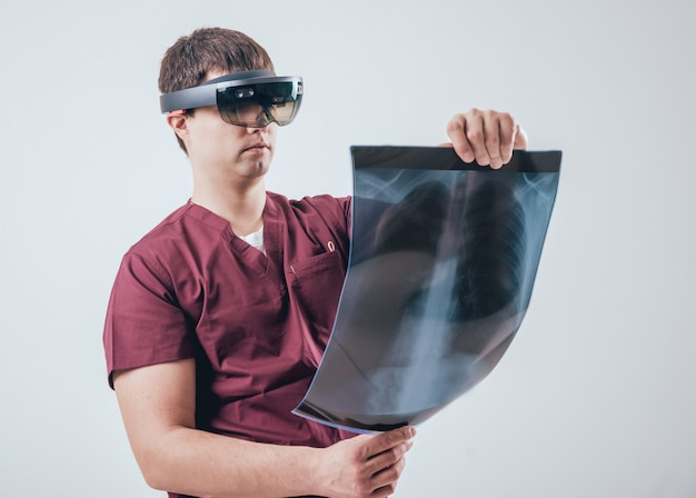 Doctor uses augmented reality goggles to exam x-rays film with human skeleton Premium Photo
