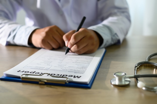 Doctor using computer medical record  medical report or medical certificate database of patient's health care Premium Photo