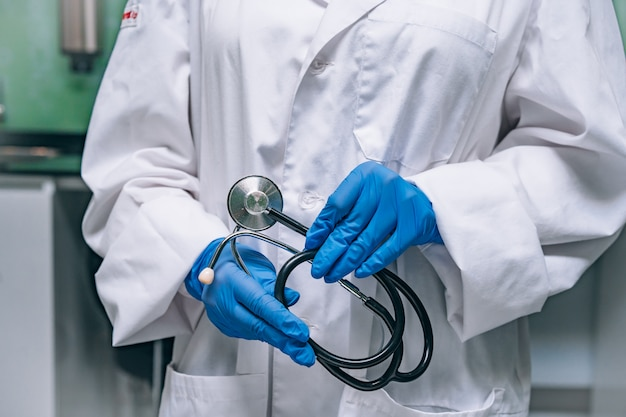 Doctor in a white robe holding a phonendoscope Free Photo