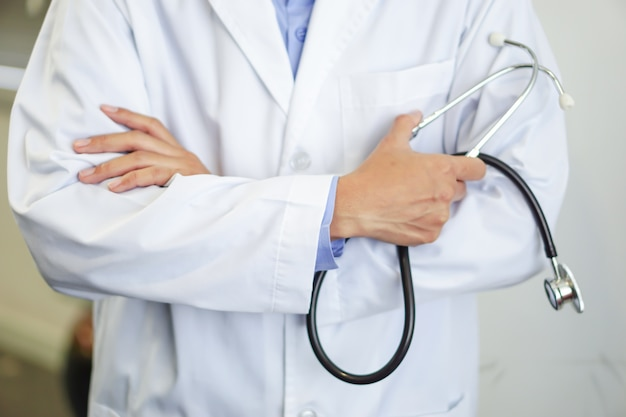 Doctor with stethoscope in the nursing hospital ward : healthy strong medical concept Premium Photo