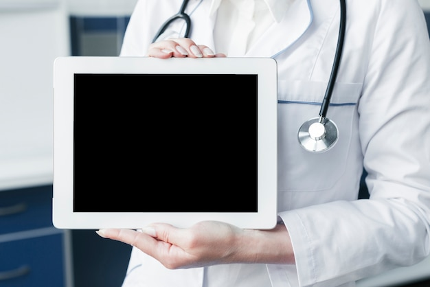 Doctor with a stethoscope and a tablet Free Photo