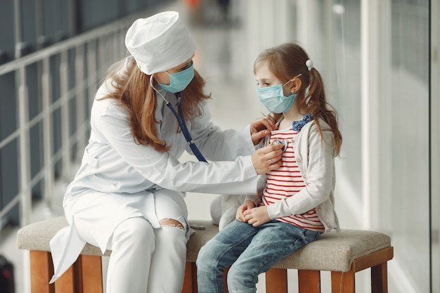 A doctor woman is examinating a child with stethoscope Free Photo