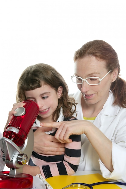 Doctor woman teacher and pupil microscope Premium Photo
