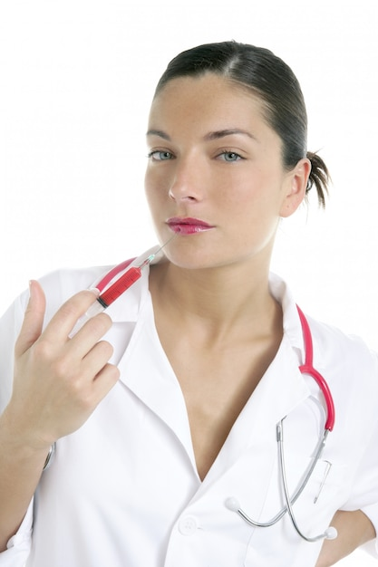 Doctor woman with red syringe in lips Premium Photo