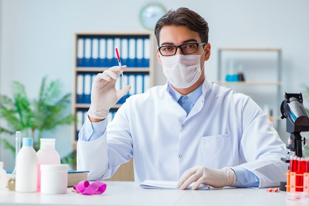 Doctor working with blood samples Premium Photo