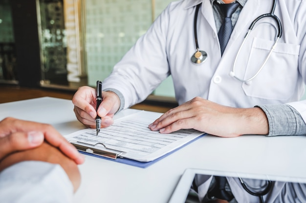 Doctors and patients consulting and diagnostic examining sit and talk. at the table near the window in the hospital medicine concept Premium Photo
