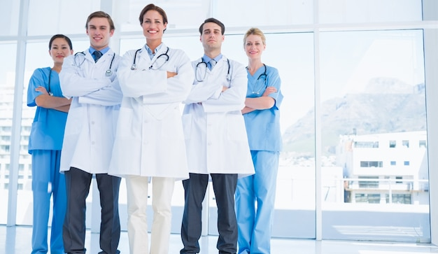 Doctors standing together at hospital Premium Photo