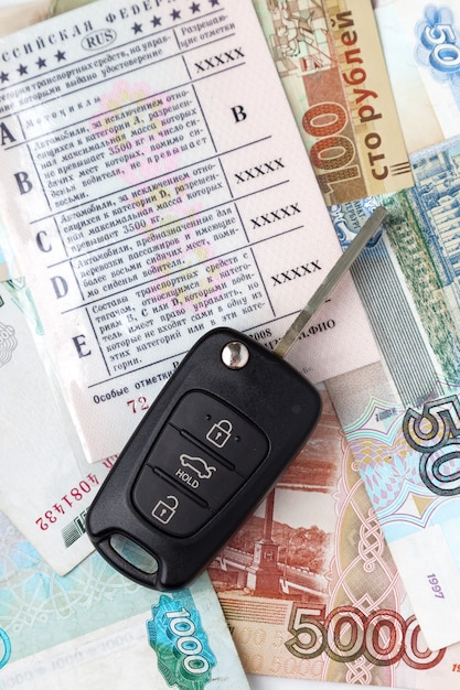 Documents car keys and money and drivers license Premium Photo
