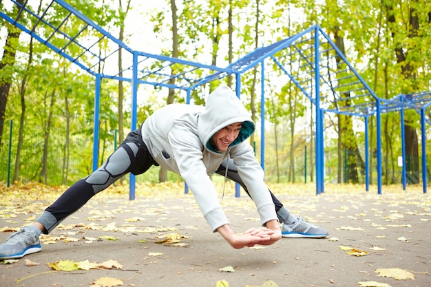 Doing stretching exercises in park Free Photo