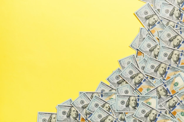 Dollar bills a on a light colored background. copy space, top view business concept Premium Photo