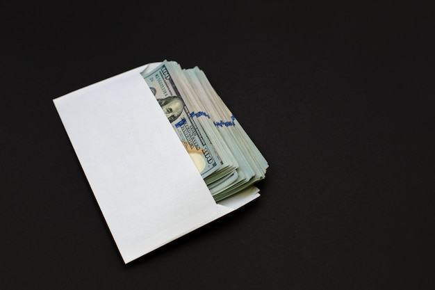 Dollar money in the envelope on black Premium Photo