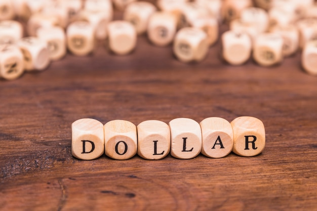 Dollar text written on wooden blocks Free Photo