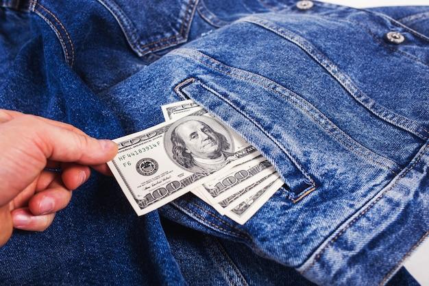Dollars in jeans pocket Premium Photo