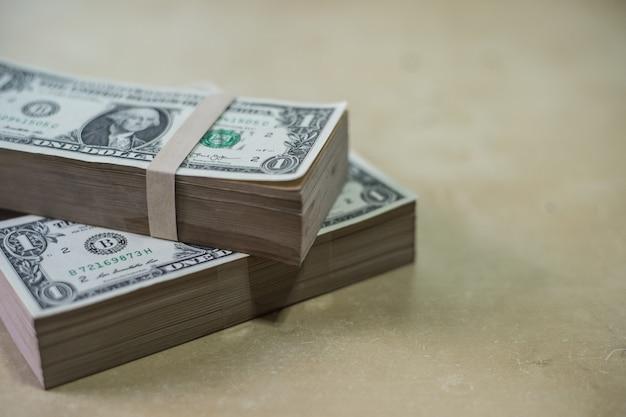 Dollars money on wood texture Photo | Premium Download