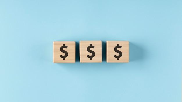 Dollars on wooden cubes arrangement Free Photo