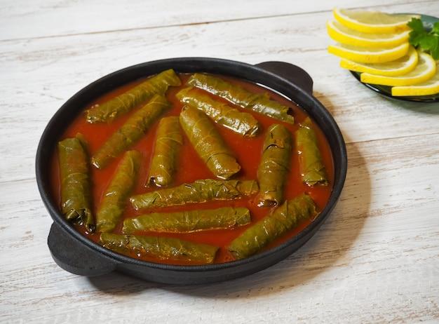 Dolma - sarma stuffed grape leaves. mediterranean cuisine. Premium Photo