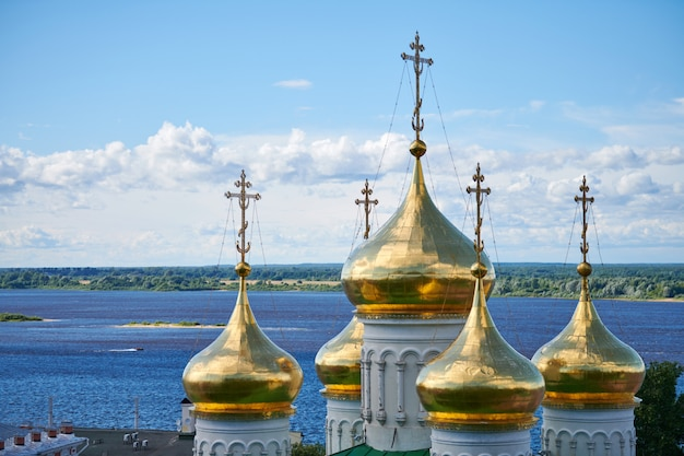 Domes of orthodox church. golden crosses of russian church. sacred place for parishioners and prayers for salvation of soul. Premium Photo