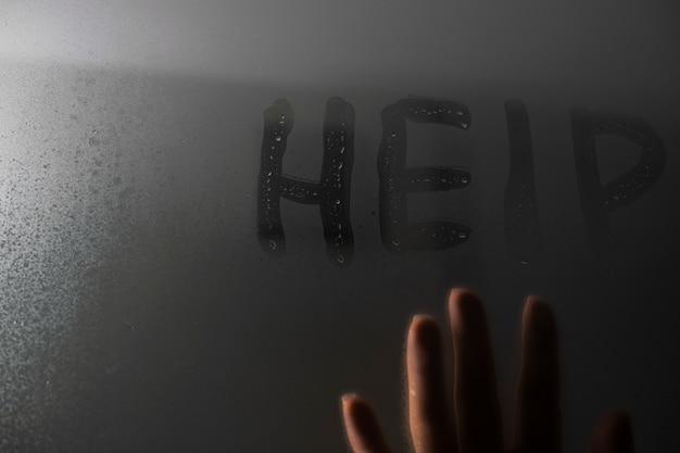 Domestic domestic violence. hand writes the word help Premium Photo