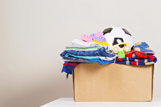 Donation box with toys, books, clothing for charity Premium Photo