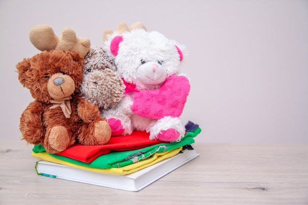Donation concept. donate box with kids clothes, books, school supplies and toys. Premium Photo