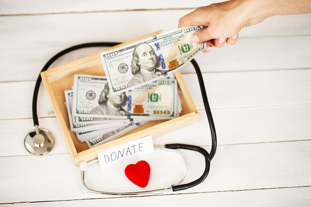 Donations and charity. donation . box of donations and heart on the white . Premium Photo