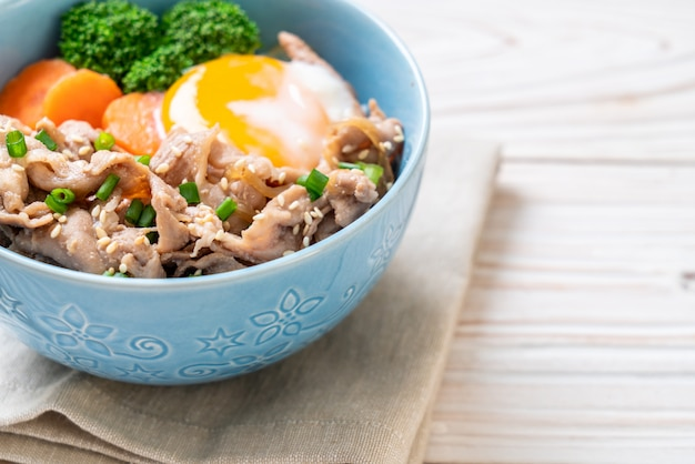 Donburi, pork rice bowl with onsen egg and vegetable Premium Photo