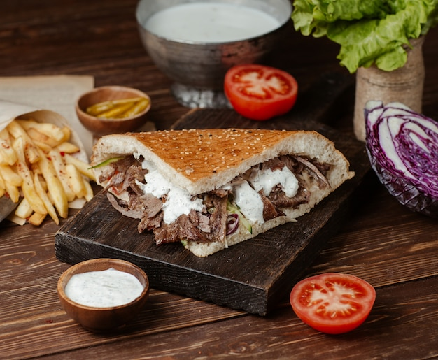 Doner burger in bread with french fries Free Photo