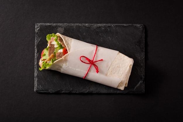 Doner kebab  on black slate Premium Photo