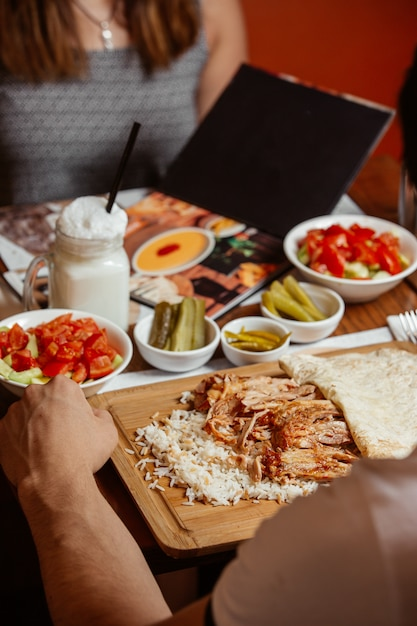 Doner kebab with rice on wooden board Free Photo