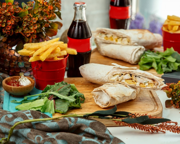 Doner set in lavash on wooden board Free Photo