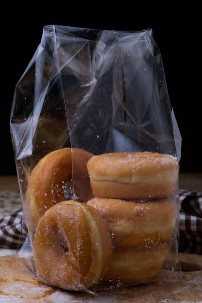 Donut in plastic bag Premium Photo