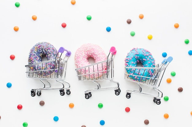 Donuts in shopping carts set Free Photo
