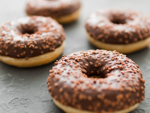 Donuts with chocolate glaze and sprinkles Free Photo