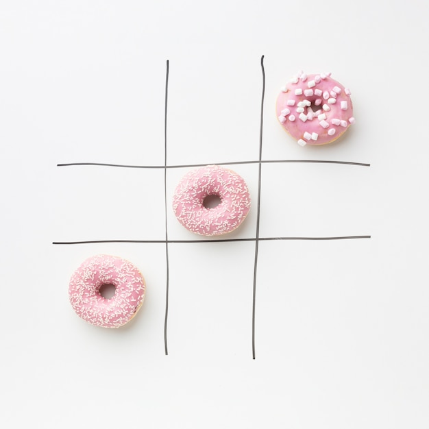 Donuts with tic tac toe concept Free Photo