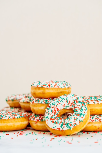 Donuts with white chocolate cream and sprinkles sugar Free Photo