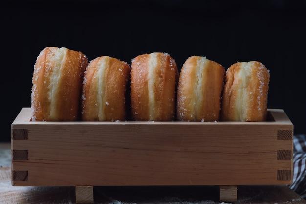 Donuts in wooden box Premium Photo