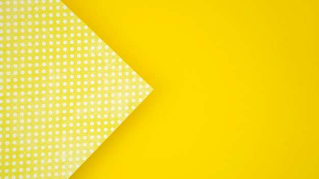 Dots on paper and yellow copy space background Free Photo