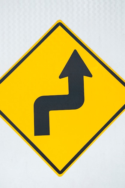 Double bend road arrow sign close-up Free Photo