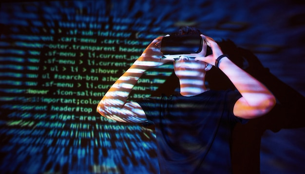 Double exposure of a caucasian man and virtual reality vr headset is presumably a gamer or a hacker cracking the code into a secure network or server, with lines of code Free Photo