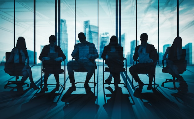 Double exposure image of many business people. Premium Photo