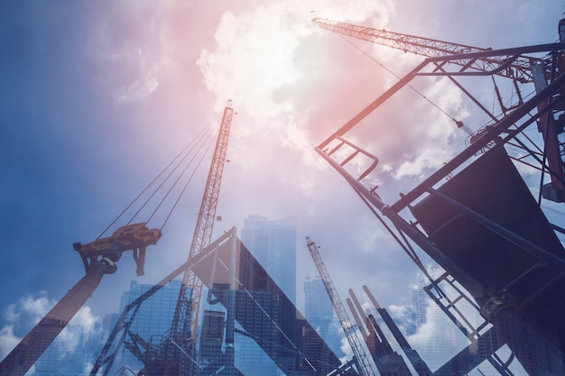 Double exposure of abstract real estate construction site and cityscape buildings Premium Photo