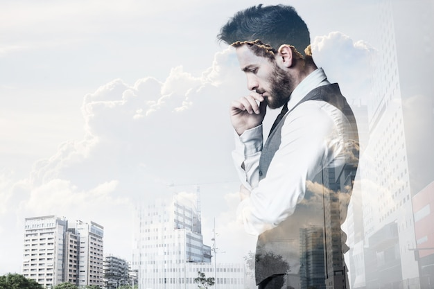 Double exposure of young businessman and city. Free Photo