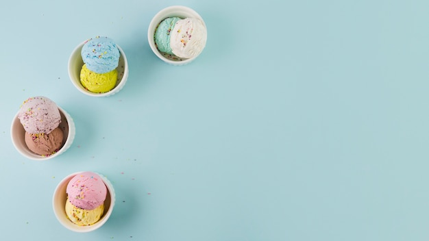 Double ice cream scoops in ceramic bowls Free Photo