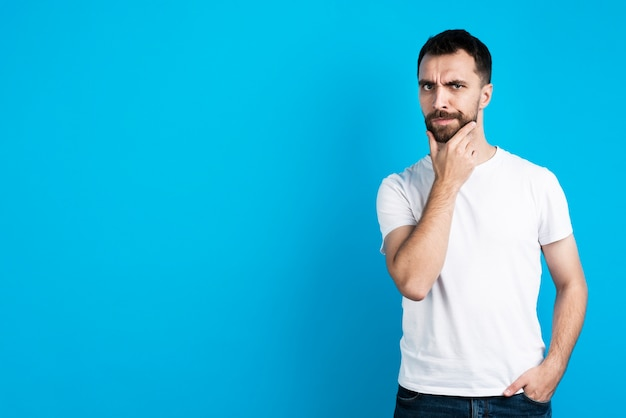 Doubtful man posing with copy space Free Photo