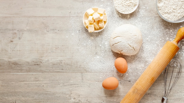 Dough kitchen roller and eggs with copy space Free Photo