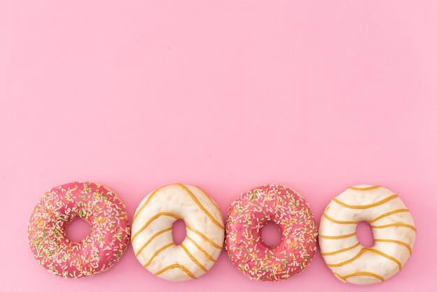 Doughnuts on pink background. Premium Photo